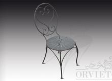 Sedia in ferro con schienale a volute e seduta decorata, finitura con vernice a piombo.