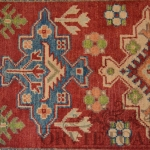 tappeto pakistano in lana disegno caucasico