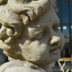 Particolare del volto scolpito nella pietra